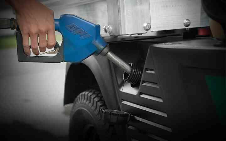 Side filling petrol tank